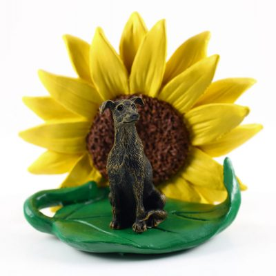 Greyhound Brindle Figurine Sitting on a Green Leaf in Front of a Yellow Sunflower