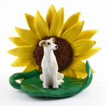 Greyhound Tan Figurine Sitting on a Green Leaf in Front of a Yellow Sunflower
