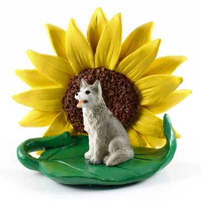 Husky Gray/White Brown Eyes Figurine Sitting on a Green Leaf in Front of a Yellow Sunflower