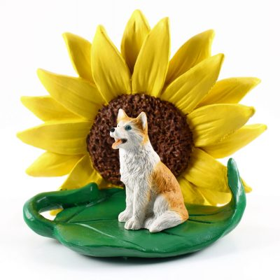 Husky Red/White Blue Eyes Figurine Sitting on a Green Leaf in Front of a Yellow Sunflower
