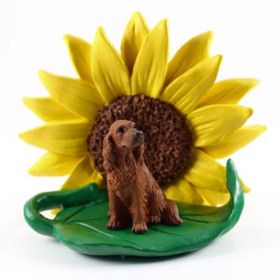 Irish Setter Figurine Sitting on a Green Leaf in Front of a Yellow Sunflower
