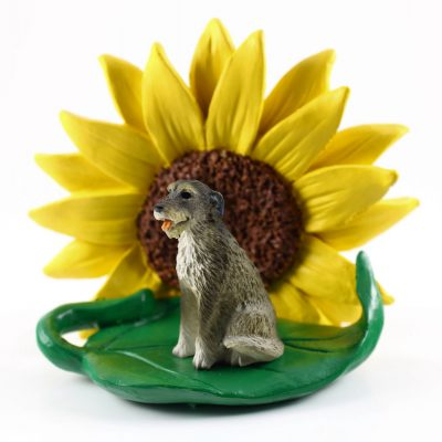 Irish Wolfhound Figurine Sitting on a Green Leaf in Front of a Yellow Sunflower