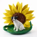 Jack Russell Terrier Black Figurine Sitting on a Green Leaf in Front of a Yellow Sunflower