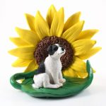 Jack Russell Terrier Black Smooth Coat Figurine Sitting on a Green Leaf in Front of a Yellow Sunflower