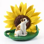 Jack Russell Terrier Brown Smooth Coat Figurine Sitting on a Green Leaf in Front of a Yellow Sunflower