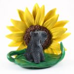 Kerry Blue Terrier Figurine Sitting on a Green Leaf in Front of a Yellow Sunflower