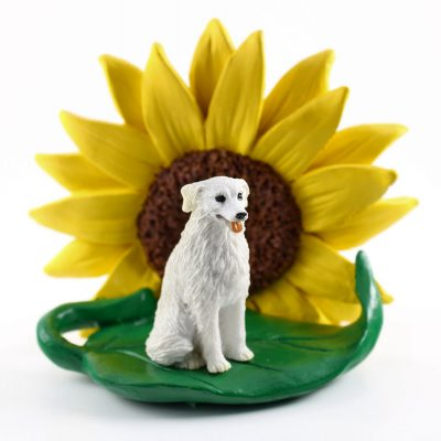 Kuvasz Figurine Sitting on a Green Leaf in Front of a Yellow Sunflower