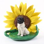 Landseer Figurine Sitting on a Green Leaf in Front of a Yellow Sunflower