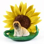 Llhasa Apso Brown Figurine Sitting on a Green Leaf in Front of a Yellow Sunflower