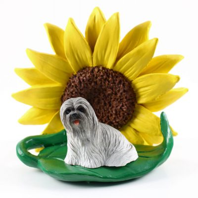 Llhasa Apso Gray Figurine Sitting on a Green Leaf in Front of a Yellow Sunflower