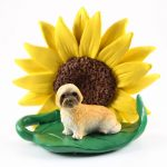 Llhasa Apso Brown Puppy Cut Figurine Sitting on a Green Leaf in Front of a Yellow Sunflower