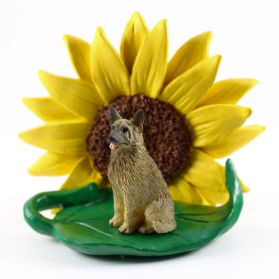 Norwegian Elkhound Figurine Sitting on a Green Leaf in Front of a Yellow Sunflower