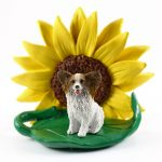Papillon Brown Figurine Sitting on a Green Leaf in Front of a Yellow Sunflower
