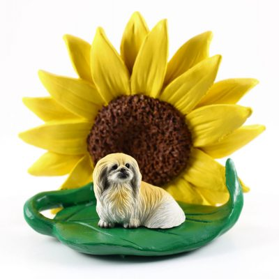 Pekingese Figurine Sitting on a Green Leaf in Front of a Yellow Sunflower