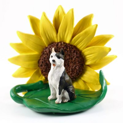 Pitbull Brindle Figurine Sitting on a Green Leaf in Front of a Yellow Sunflower