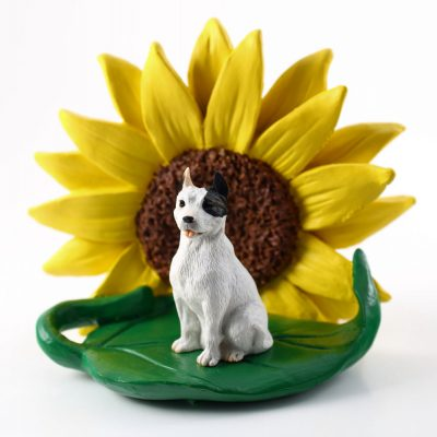 Pitbull White Figurine Sitting on a Green Leaf in Front of a Yellow Sunflower