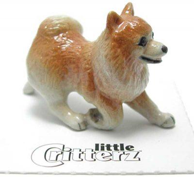 Pomeranian Hand Painted Porcelain Miniature Figurine