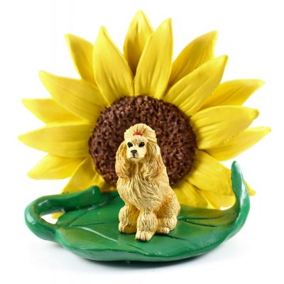 Poodle Apricot Figurine Sitting on a Green Leaf in Front of a Yellow Sunflower