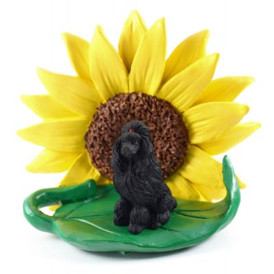 Poodle Black Figurine Sitting on a Green Leaf in Front of a Yellow Sunflower