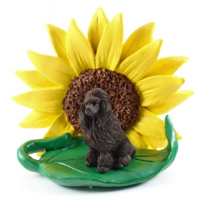 Poodle Chocolate Figurine Sitting on a Green Leaf in Front of a Yellow Sunflower