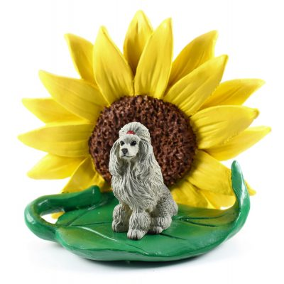 Poodle Gray Figurine Sitting on a Green Leaf in Front of a Yellow Sunflower