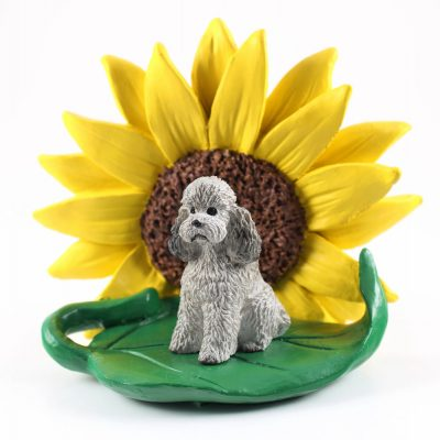 Poodle Gray Sport Cut Figurine Sitting on a Green Leaf in Front of a Yellow Sunflower