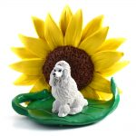 Poodle White Figurine Sitting on a Green Leaf in Front of a Yellow Sunflower