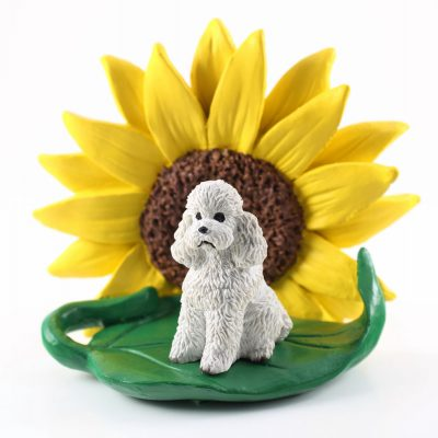 Poodle White Sport Cut Figurine Sitting on a Green Leaf in Front of a Yellow Sunflower