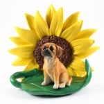 Puggle Figurine Sitting on a Green Leaf in Front of a Yellow Sunflower
