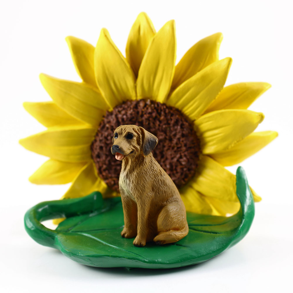 Rhodesian Ridgeback Figurine Sitting on a Green Leaf in Front of a Yellow Sunflower