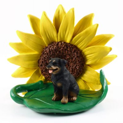 Rottweiler Figurine Sitting on a Green Leaf in Front of a Yellow Sunflower