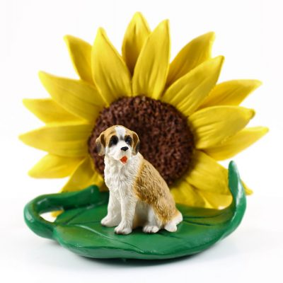 Saint Bernard Rough Coat Figurine Sitting on a Green Leaf in Front of a Yellow Sunflower
