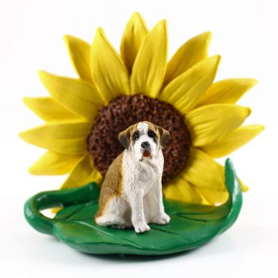 Saint Bernad Smooth Coat Figurine Sitting on a Green Leaf in Front of a Yellow Sunflower