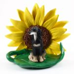 Saluki Figurine Sitting on a Green Leaf in Front of a Yellow Sunflower