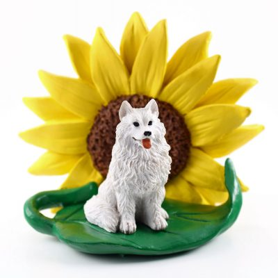 Samoyed Figurine Sitting on a Green Leaf in Front of a Yellow Sunflower