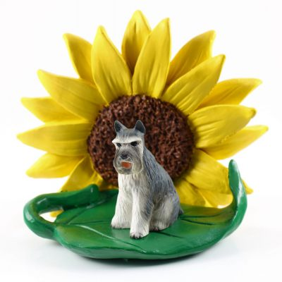 Schnauzer Gray Figurine Sitting on a Green Leaf in Front of a Yellow Sunflower