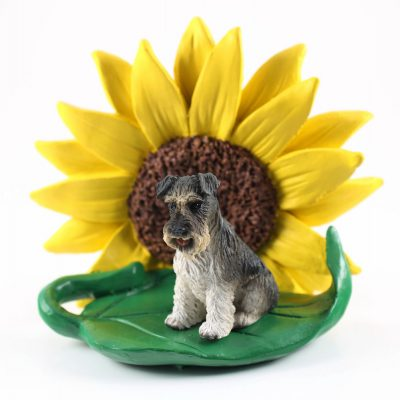 Schnauzer Gray Uncropped Figurine Sitting on a Green Leaf in Front of a Yellow Sunflower