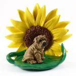 Shar Pei Brown Figurine Sitting on a Green Leaf in Front of a Yellow Sunflower
