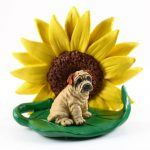 Shar Pei Cream Figurine Sitting on a Green Leaf in Front of a Yellow Sunflower