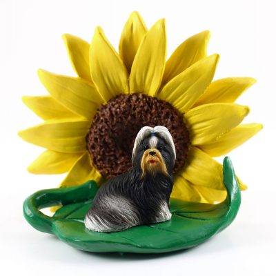 Shih Tzu Black/White Figurine Sitting on a Green Leaf in Front of a Yellow Sunflower