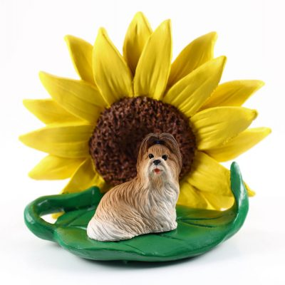 Shih Tzu Brown Figurine Sitting on a Green Leaf in Front of a Yellow Sunflower