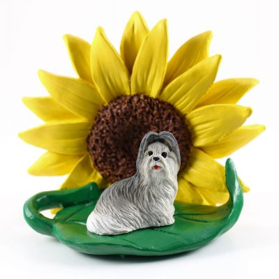 Shih Tzu Gray Figurine Sitting on a Green Leaf in Front of a Yellow Sunflower