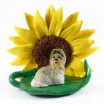 Shih Tzu Mixed Colored Figurine Sitting on a Green Leaf in Front of a Yellow Sunflower