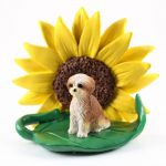 Shih Tzu Tan Puppy Cut Figurine Sitting on a Green Leaf in Front of a Yellow Sunflower
