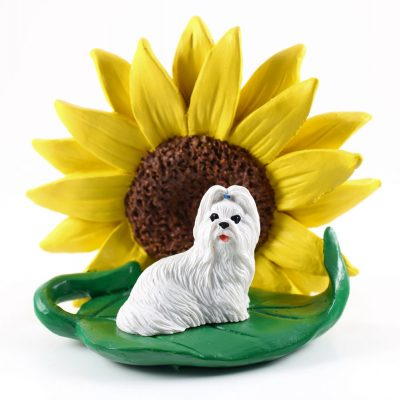 Shih Tzu White Figurine Sitting on a Green Leaf in Front of a Yellow Sunflower