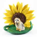Silky Terrier Figurine Sitting on a Green Leaf in Front of a Yellow Sunflower