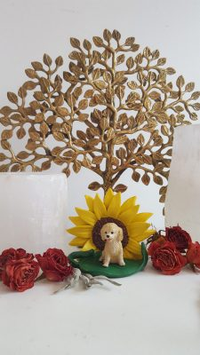 Sunflower Dog Figurine on Table