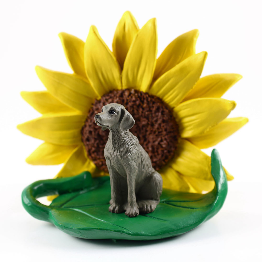 Weimaraner Figurine Sitting on a Green Leaf in Front of a Yellow Sunflower