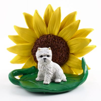 Westie Figurine Sitting on a Green Leaf in front of a Yellow Sunflower