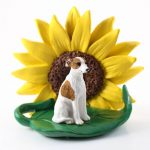 Whippet Brindle Figurine Sitting on a Green Leaf in front of a Yellow Sunflower